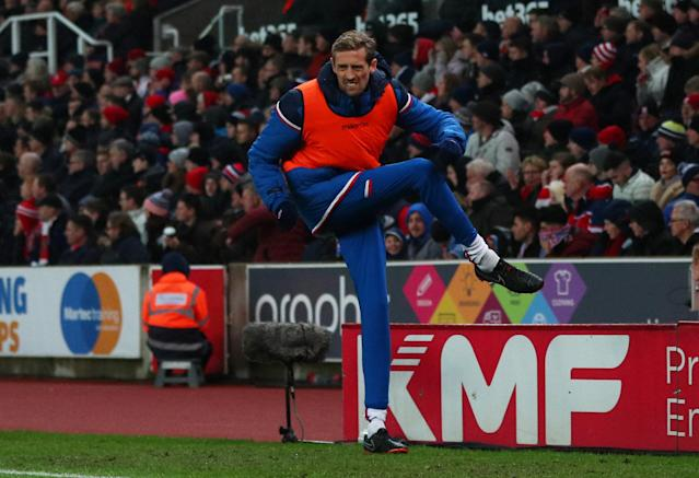 "Soccer Football - Premier League - Stoke City vs Manchester City - bet365 Stadium, Stoke-on-Trent, Britain - March 12, 2018 Stoke City's Peter Crouch warms up REUTERS/Hannah McKay EDITORIAL USE ONLY. No use with unauthorized audio, video, data, fixture lists, club/league logos or ""live"" services. Online in-match use limited to 75 images, no video emulation. No use in betting, games or single club/league/player publications. Please contact your account representative for further details."