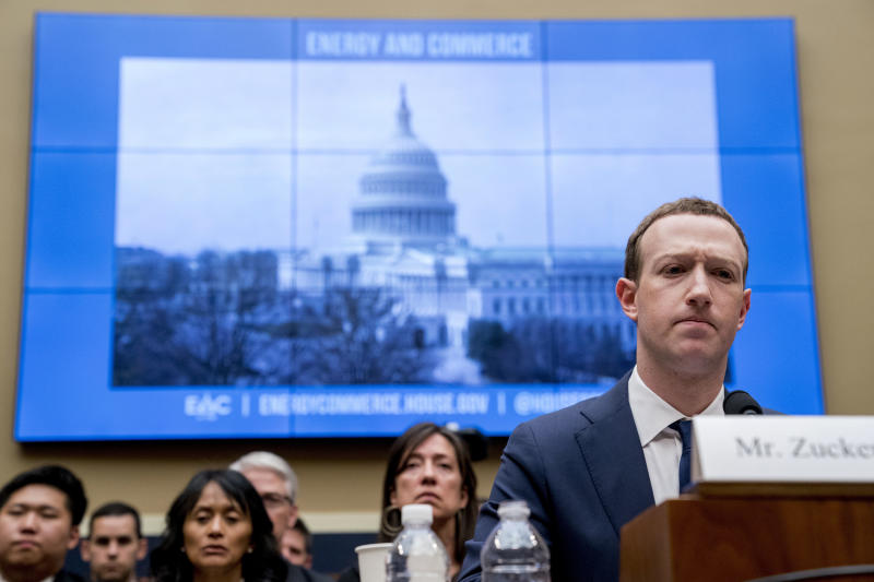 FILE - In this April 11, 2018, file photo Facebook CEO Mark Zuckerberg pauses while testifying before a House Energy and Commerce hearing on Capitol Hill in Washington. Federal regulators are fining Facebook $5 billion for privacy violations and instituting new oversight and restrictions on its business. But they are only holding Zuckerberg personally responsible in a limited fashion. (AP Photo/Andrew Harnik, File)
