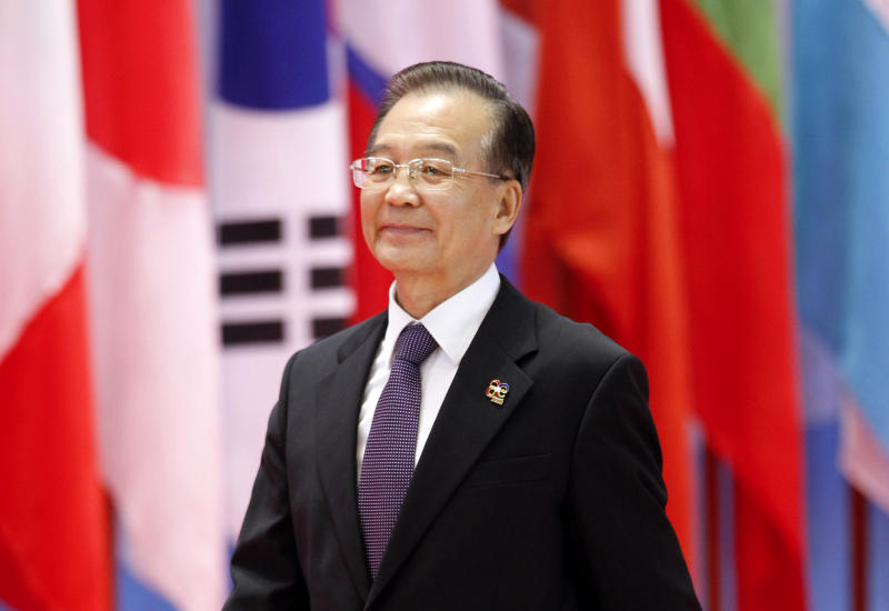 FILE - In this Nov. 5, 2012 file photo, China's Premier Wen Jiabao arrives for the opening ceremony of the ASEM Summit in Vientiane, Laos. China's finding the once friendly ground of Southeast Asia bumpy going, with anger against Chinese claims to disputed islands, once reliable ally Myanmar flirting with democracy and renewed American attention to the region. (AP Photo/Vincent Thian, File)
