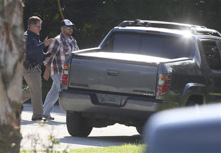 Geroge Zimmerman walks toward his vehicle before entering a house in Lake Mary Florida