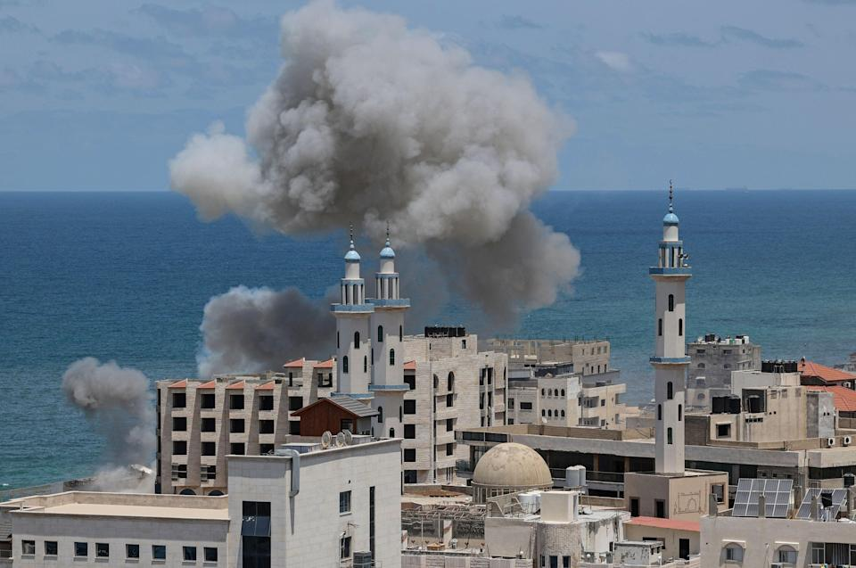 <p>Smoke billows from the the area around the port of Gaza City following Israeli bombardment from the sea on May 17</p> (Photo by MAHMUD HAMS/AFP via Getty Images)