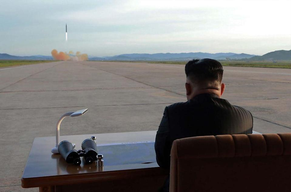 Kim Jong-un watches a missile test (Picture: Getty)