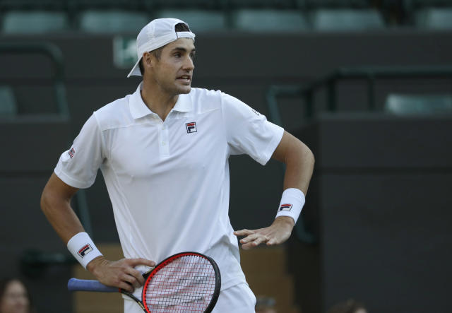 John Isner of the United States reacts to noise from the spectators during his men's quarterfinals match against Canada's Milos Raonic, at the Wimbledon Tennis Championships, in London, Wednesday July 11, 2018. (AP Photo/Ben Curtis)