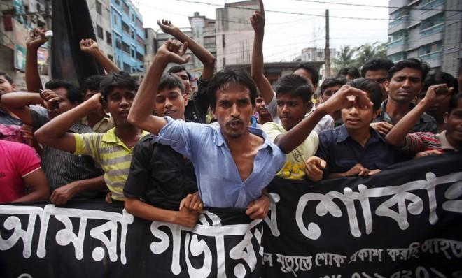Workers at a garment factory streets away from the collapsed building in Dhaka protest dangerous working conditions on April 30.