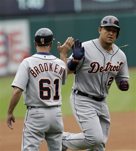 Detroit Tigers' Miguel Cabrera, right, is congratulated by third base coach Tom Brookens after hitting a solo home run in the first inning of a baseball game on Sunday, July 7, 2013, in Cleveland. (AP Photo/Tony Dejak)