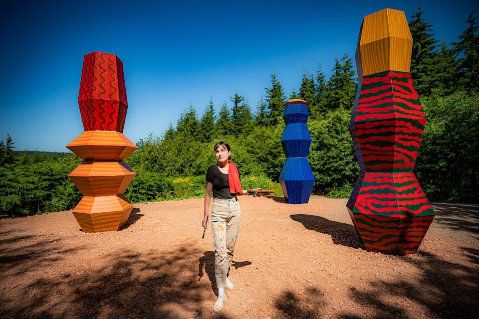 Artist Alicja Biala with her Totems artwork, which symbolises the relationship between humans and the forces of nature (Ben Birchall/PA) (PA Wire)