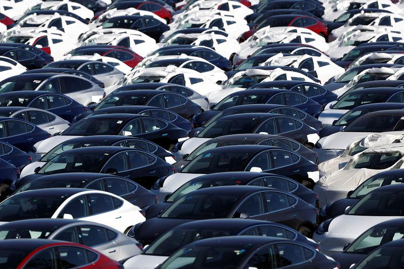 FILE PHOTO - A parking lot of predominantly new Tesla Model 3 electric vehicles is seen in Richmond, California