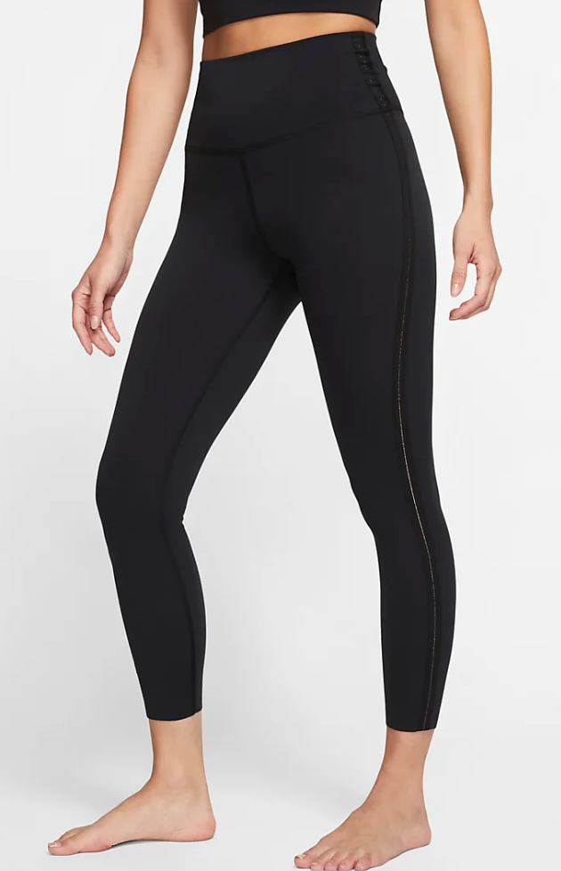 Nike just discounted tanks, tights and hoodies from their popular yoga collection at up to 40% off
