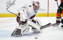 Colorado Avalanche goaltender Philipp Grubauer looks to stop a shot by the Anaheim Ducks in the second period of an NHL hockey game Friday, March 5, 2021, in Denver. (AP Photo/David Zalubowski)