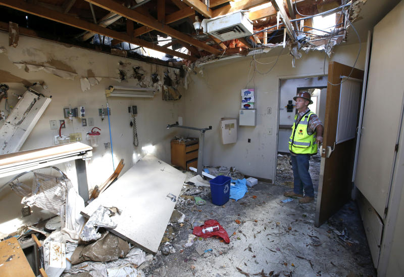 In this Thursday, Oct. 17, 2019, photo, Joe Budds, a construction foreman for Otto Construction, inspects one of the rooms at the Feather River Hospital that was damaged during last year's Camp Fire in Paradise, Calif. Once the town's largest employer, Feather River Hospital is still closed but plans are in the works to reopen the emergency room. (AP Photo/Rich Pedroncelli)