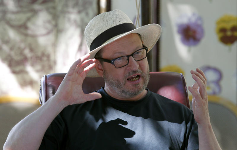 Director Lars Von Trier poses for photos during an interview in Mougins, southern France, Friday, May 20, 2011. On Thursday, May 19, 2011 the Danish filmmaker was booted out of the Cannes Film Festival for a bizarre, rambling news conference in which he said he sympathizes with Adolph Hitler. (AP Photo/Francois Mori)