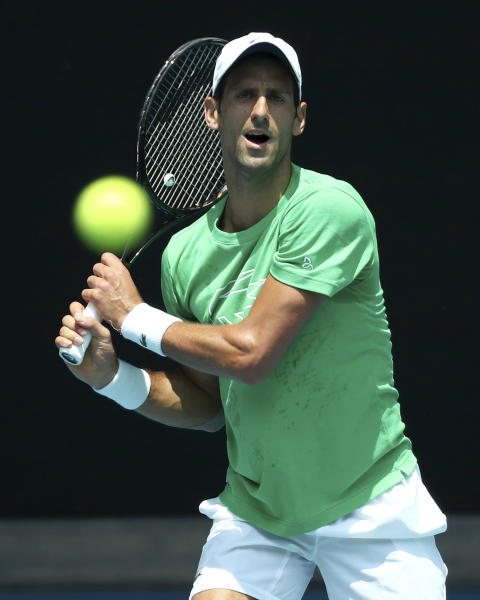 Serbia's Novak Djokovic hits a backhand return during a practice session ahead of the Australian Open tennis championship in Melbourne, Australia, Sunday, Jan. 19, 2020. (AP Photo/Dita Alangkara)