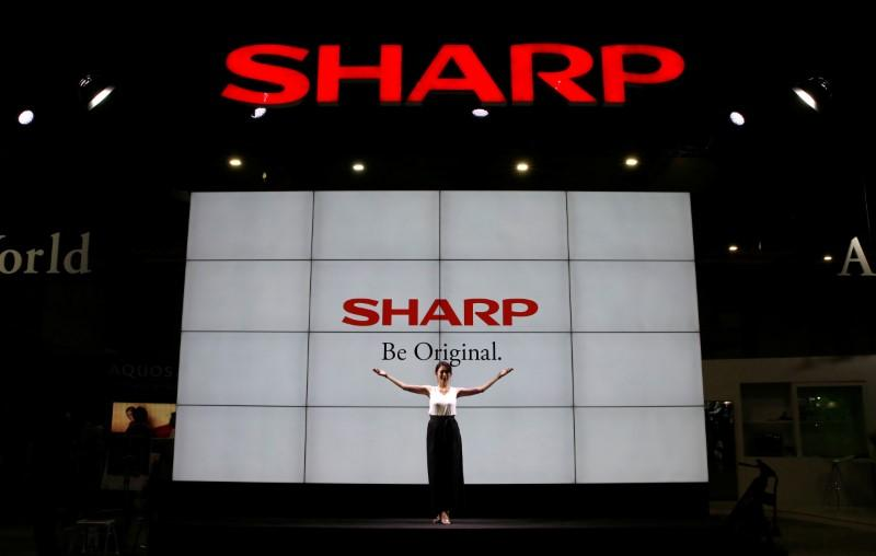 FILE PHOTO: Logos of Sharp Corp are pictured at the CEATEC JAPAN 2017 in Chiba