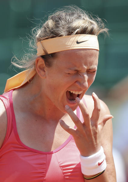 Belarus' Victoria Azarenka reacts shortly before defeating Italy's Alberta Brianti during their first round match in the French Open tennis tournament at the Roland Garros stadium in Paris, Monday, May, 28, 2012. Azarenka won 6-7, 6-4, 6-2. (AP Photo/David Vincent)