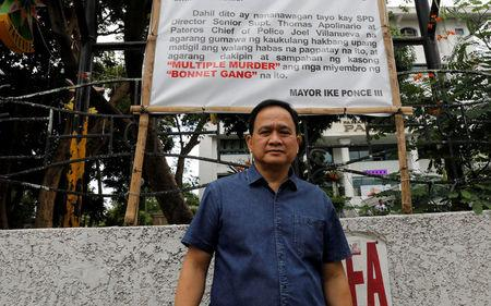 Filipino Mayor Ike Ponce poses in front of a banner denouncing the Bonnet Gang, outside the municipal hall in the Philippine town of Pateros, Metro Manila, Philippines March 16, 2017. REUTERS/Erik De Castro