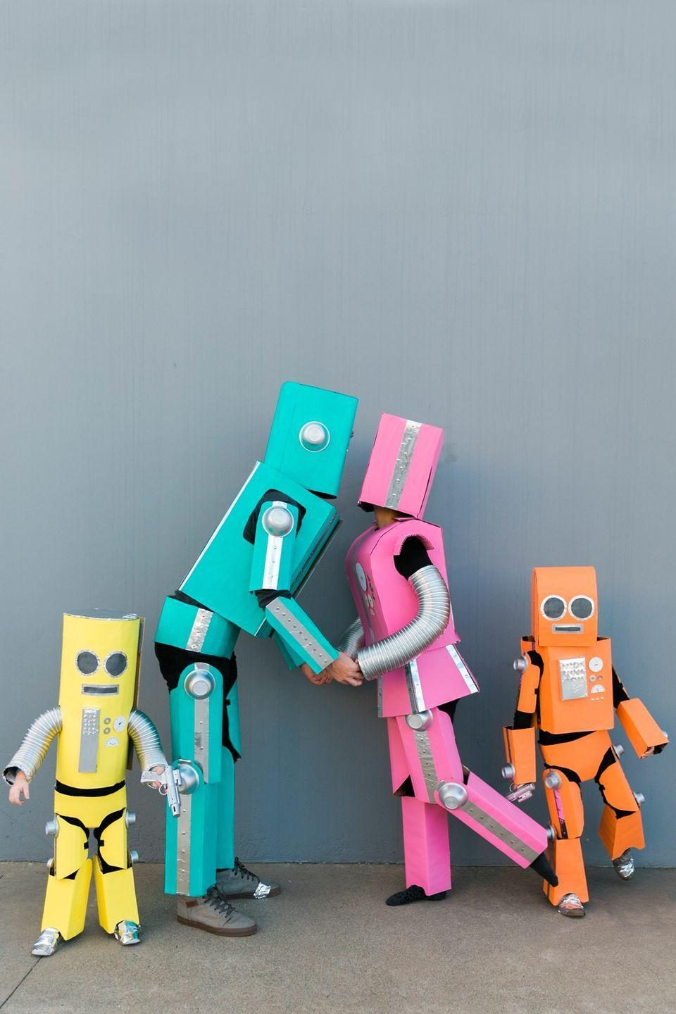 """<p>Robots have feelings too, you know! ...Well, these family-friendly, brightly colored ones do, anyway.</p><p><strong>Get the tutorial at <a href=""""https://tellloveandparty.com/2017/09/diy-robot-family-costume.html"""" rel=""""nofollow noopener"""" target=""""_blank"""" data-ylk=""""slk:Tell Love & Party"""" class=""""link rapid-noclick-resp"""">Tell Love & Party</a>. </strong></p><p><a class=""""link rapid-noclick-resp"""" href=""""https://www.amazon.com/Corrugated-Cardboard-Sheets-24-Pack-Inserts/dp/B079QRBBFP?tag=syn-yahoo-20&ascsubtag=%5Bartid%7C10050.g.29074815%5Bsrc%7Cyahoo-us"""" rel=""""nofollow noopener"""" target=""""_blank"""" data-ylk=""""slk:SHOP CARDBOARD"""">SHOP CARDBOARD</a></p>"""