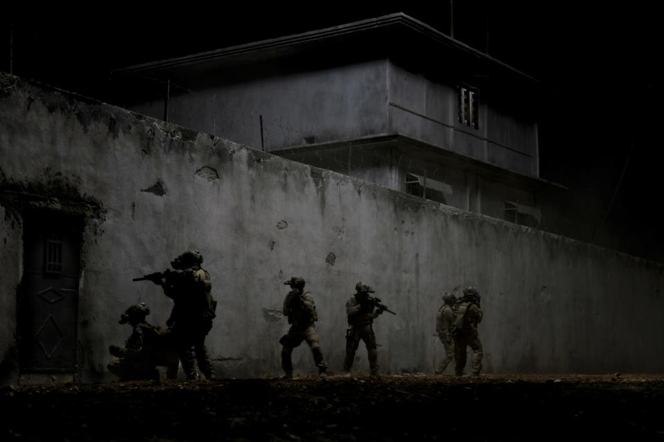 """FILE - This undated publicity film image provided by Columbia Pictures Industries, Inc. shows elite Navy SEALs raiding Osama Bin Laden's compound in the dark night in Columbia Pictures' gripping new thriller directed by Kathryn Bigelow, """"Zero Dark Thirty."""" Bigelow's Osama bin Laden thriller """"Zero Dark Thirty,"""" Steven Spielberg's Civil War epic """"Lincoln"""" and Christopher Nolan's superhero tale """"The Dark Knight Rises"""" are among the American Film Institute's top-10 movies of the year., announced on Monday, Dec. 10, 2012. (AP Photo/Columbia Pictures Industries, Inc., Jonathan Olley, File)"""