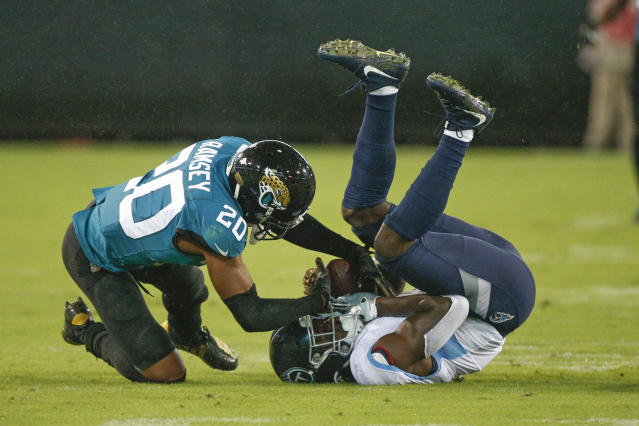 Jacksonville Jaguars cornerback Jalen Ramsey (20) tries to strip the ball from the hands of Tennessee Titans wide receiver A.J. Brown, right, after a reception during the first half of an NFL football game, Thursday, Sept. 19, 2019, in Jacksonville, Fla. (AP Photo/Stephen B. Morton)