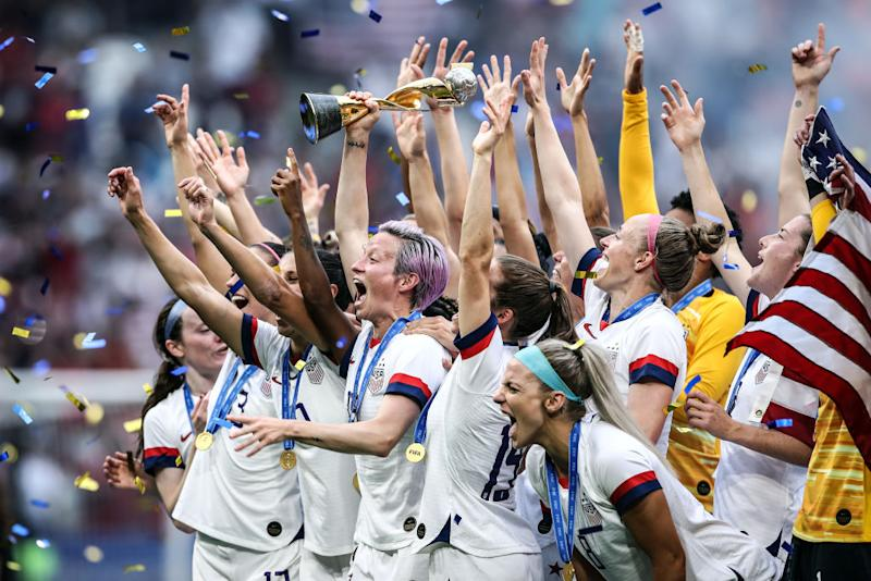 Megan Rapinoe of the USA lifts the FIFA Women's World Cup Trophy following her team's victory in the 2019 FIFA Women's World Cup France Final match between The United States of America and The Netherlands at Stade de Lyon on July 07, 2019 in Lyon, France. | Alex Grimm—Getty Images