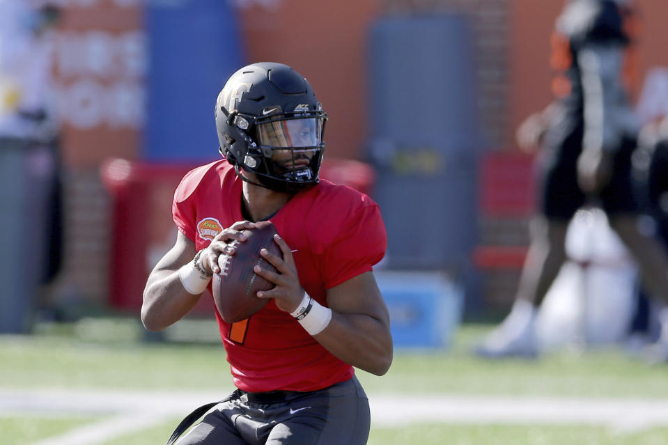 Quarterback Jamie Newman of Wake Forest (7) had an up-and-down week at the Senior Bowl. (AP Photo/Rusty Costanza)