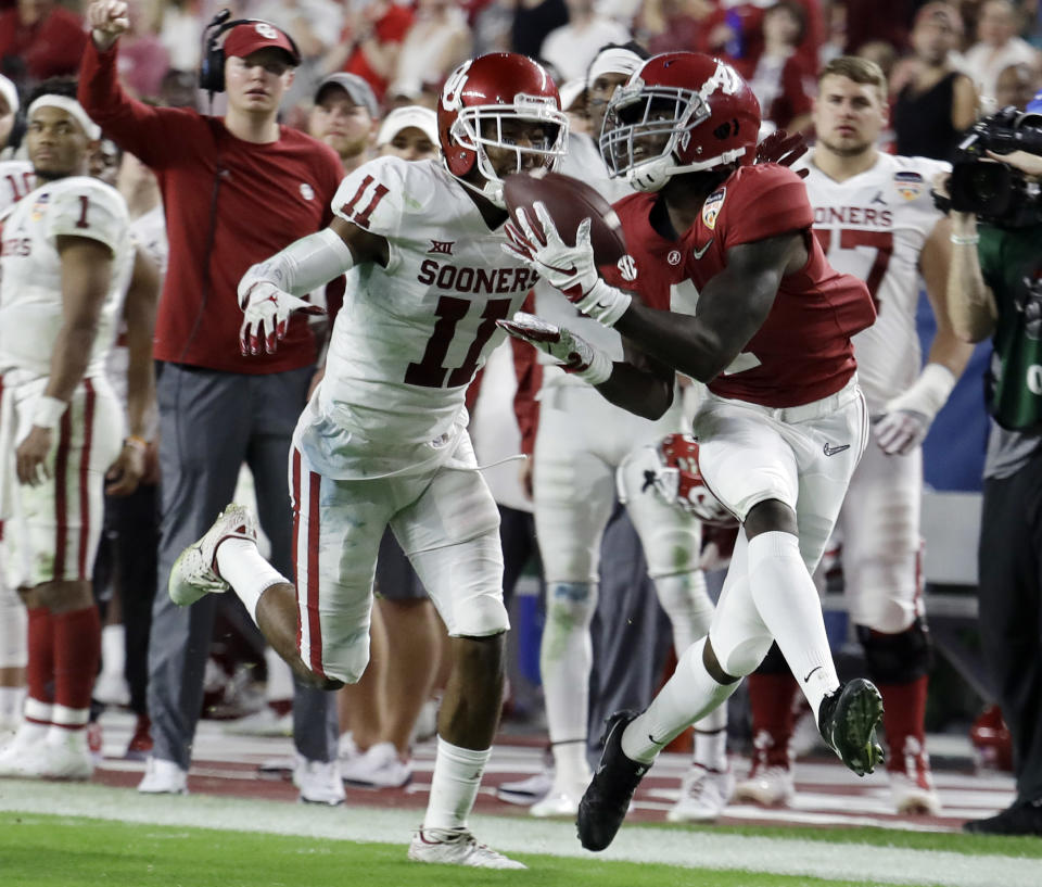 Alabama wide receiver Jerry Jeudy (4) eyes a pass as Oklahoma cornerback Parnell Motley (11) attempts to defend, during the second half of the Orange Bowl NCAA college football game, Saturday, Dec. 29, 2018, in Miami Gardens, Fla. (AP Photo/Lynne Sladky)
