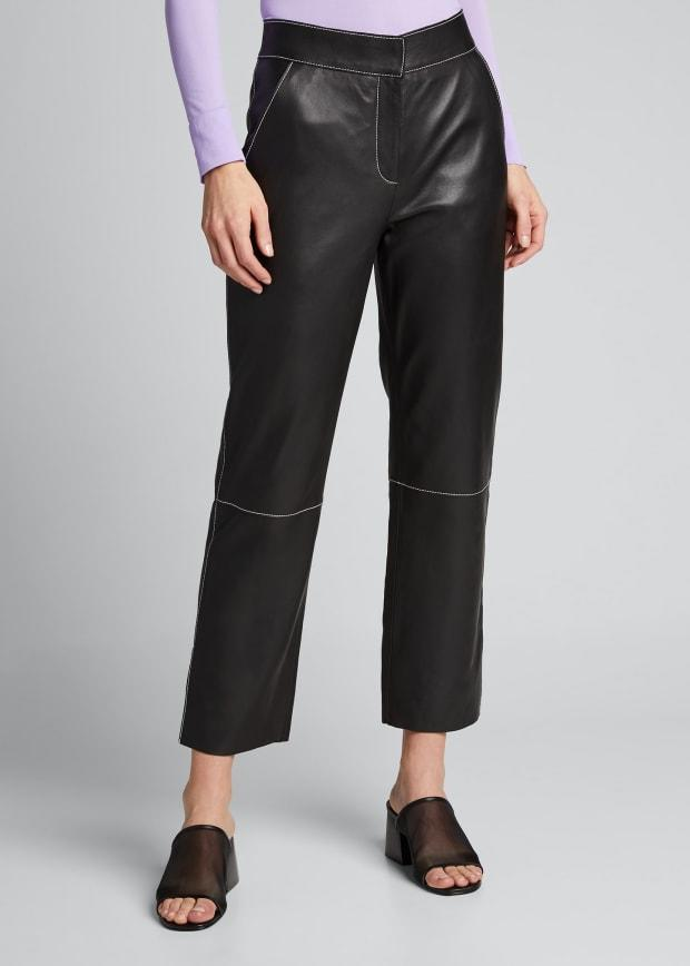 "<p>Stand Zoe Lamb Leather Straight-Leg Pants, $148.20 (from $494), <a href=""https://www.bergdorfgoodman.com/p/stand-zoe-lamb-leather-straight-leg-pants-prod154310123?ecid=BGCS__GooglePLA&utm_source=google_shopping&adpos=&scid=scplpsku121990634&sc_intid=sku121990634&gclid=EAIaIQobChMI7_6VzdTS6gIV5QiICR1QpQPREAQYAiABEgJbofD_BwE&gclsrc=aw.ds"" rel=""nofollow noopener"" target=""_blank"" data-ylk=""slk:available here"" class=""link rapid-noclick-resp"">available here</a>. </p>"
