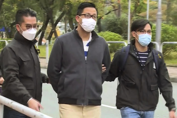 In this image taken from a video, Hong Kong's Democratic Party member and former lawmaker Lam Cheuk-ting, center, is arrested by police officers at his home in Hong Kong, Wednesday, Jan. 6, 2021. Hong Kong police arrested about 50 pro-democracy figures Wednesday for allegedly violating the new national security law by participating in an unofficial primary election last year held to increase their chances of controlling the legislature, according to political parties and local media. (TVB via AP)