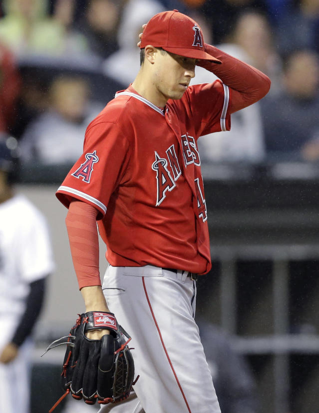 Los Angeles Angels starter Tyler Skaggs reacts after Chicago White Sox's Alexei Ramirez hit a two-run single during the fourth inning of a baseball game in Chicago on Wednesday, July 2, 2014. (AP Photo/Nam Y. Huh)