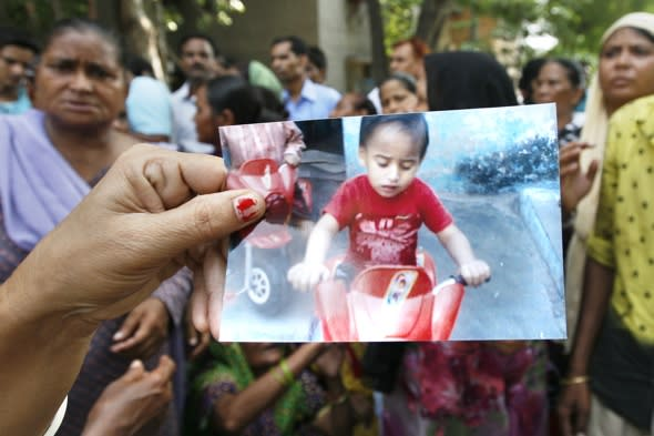 Boy dies in vat of boiling sugar syrup after rickshaw knocks him from mother's arms in India