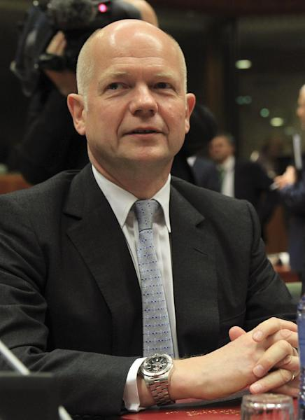 British Foreign Secretary William Hague attends an EU foreign ministers meeting at the European Council building in Brussels Monday, May 12, 2014. EU foreign ministers discuss the situation in Ukraine. (AP Photo/Yves Logghe)