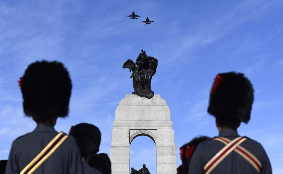 Royal Canadian Air CF-18s fly over the National War Memorial
