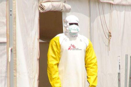 A Doctors Without Borders health worker stands in an Ebola virus treatment centre in Conakry, Guinea (Reuters)