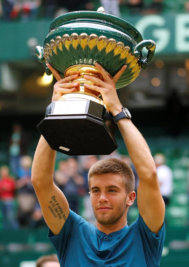 Tennis - ATP - Halle Open Finals - Gerry Weber Stadion, Halle, Germany - June 24, 2018 Croatia's Borna Coric poses with the trophy after winning the final against Switzerland's Roger Federer REUTERS/Leon Kuegeler
