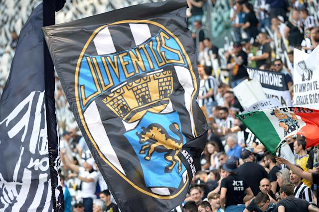 Soccer Football - Serie A - Juventus vs Hellas Verona - Allianz Stadium, Turin, Italy - May 19, 2018 Juventus fans wave flags before the match REUTERS/Massimo Pinca