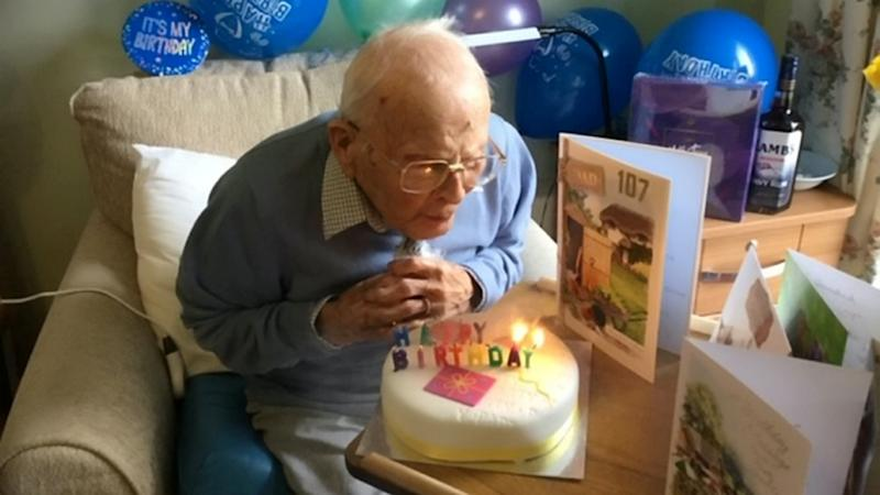 Reg Lewis celebrated with a cake (Picture: SWNS)