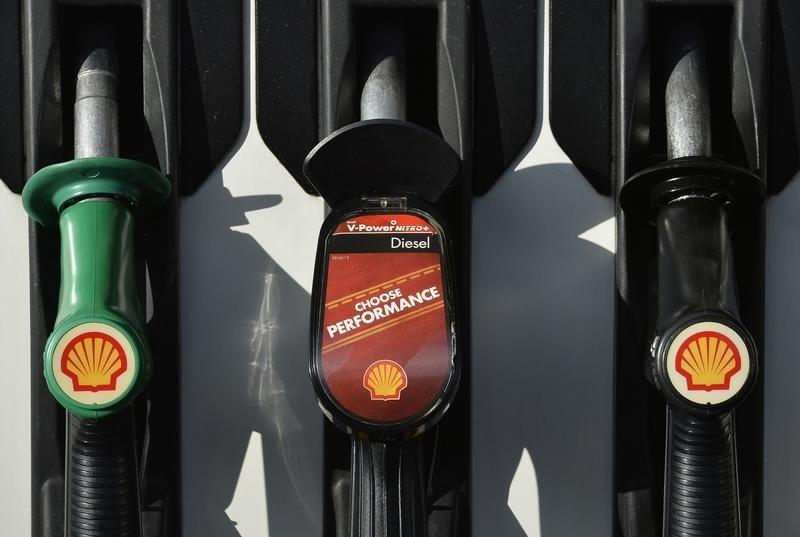 Shell logos are seen on fuel pumps at a petrol station in west London, January 29, 2015. REUTERS/Toby Melville