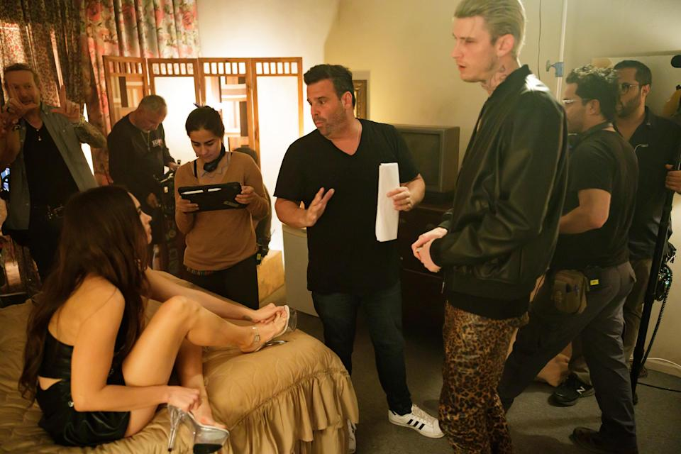 Megan Fox and Colson Baker (in the leopard pants) talking and falling in love.