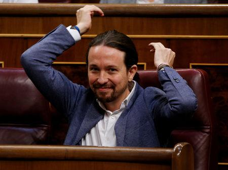 FILE PHOTO: Podemos leader Pablo Iglesias adjusts his ponytail during a motion of no confidence debate in parliament in Madrid, Spain, June 13, 2017. REUTERS/Juan Medina/File Photo