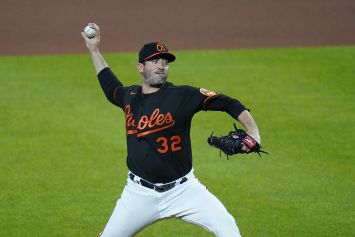 Baltimore Orioles starting pitcher Matt Harvey throws a pitch to the wBoston Red Sox during the first inning of a baseball game, Friday, May 7, 2021, in Baltimore. (AP Photo/Julio Cortez)