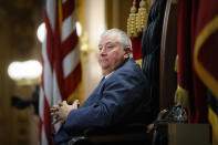 FILE - In this Wednesday, Oct. 30, 2019, file photo, Republican Ohio state Rep. Larry Householder sits at the head of a legislative session as Speaker of the House, in Columbus. Householder is charged in a $60 million bribery case, alleging he helped a $1 billion nuclear plant bailout. The 2020 arrests of Householder and four associates in connection with the scheme have rocked politics and business across Ohio. (AP Photo/John Minchillo, File)