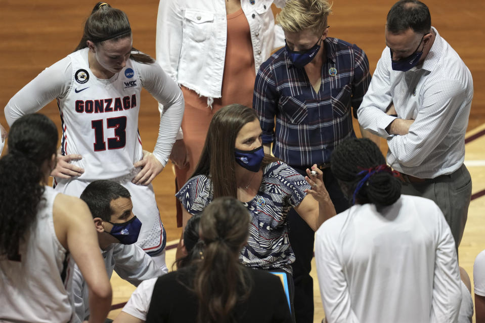 Gonzaga head coach Lisa Fortier, center, talks to her team during the first half of a college basketball game against Belmont in the first round of the women's NCAA tournament at the University Events Center in San Marcos, Texas, Monday, March 22, 2021. (AP Photo/Chuck Burton)