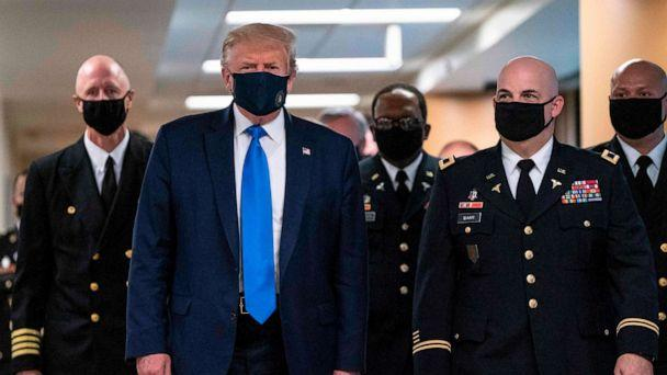 PHOTO: TOPSHOT - US President Donald Trump wears a mask as he visits Walter Reed National Military Medical Center in Bethesda, Maryland' on July 11, 2020.  (Alex Edelman/AFP via Getty Images)