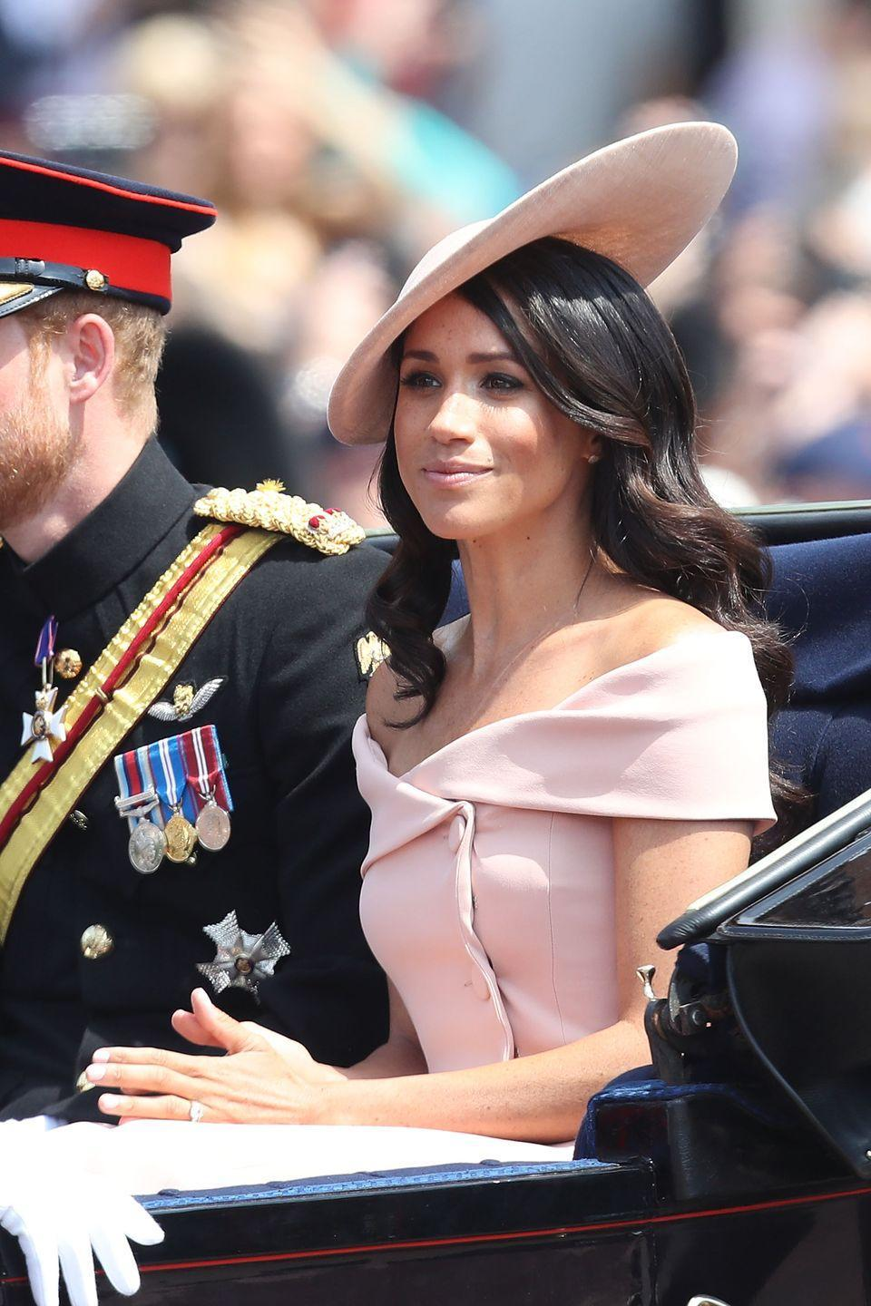 """<p>At Trooping the Colour in 2018, which was Meghan's second official appearance after her royal wedding, she opted for an off-the-shoulder Carolina Herrera dress. Stunning, no? Some thought it broke the """"rule"""" that royal women should dress modestly and not show too much skin—especially considering it was a daytime event. Don't tell the Queen, but this dress seems pretty modest to me...</p>"""