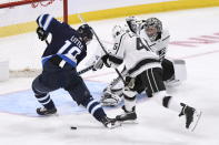 Winnipeg Jets' Bryan Little (18) fans on a shot attempt on Los Angeles Kings goaltender Jonathan Quick (32) as Blake Lizotte (46) defends during the third period of an NHL hockey game Tuesday, Oct. 22, 2019, in Winnipeg, Manitoba. (Fred Greenslade/The Canadian Press via AP)