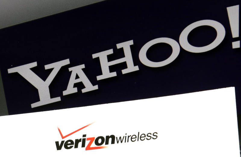 Yahoo Finance parent company Verizon will be among the mega cap companies reporting earnings on Tuesday. (AP Photo/Elise Amendola)