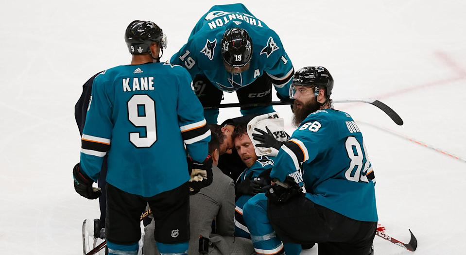 San Jose's Joe Pavelski receives treatment on the ice after being injured in the third period against the Vegas Golden Knights on Tuesday night. (Photo by Lachlan Cunningham/Getty Images)