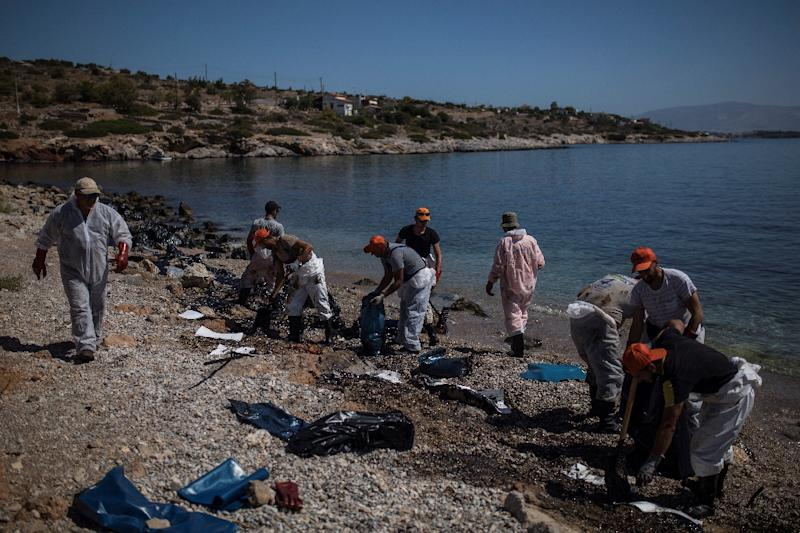 Oil from the spill quickly covered beaches and coves on the southeastern side of Salamis island (AFP Photo/Angelos Tzortzinis)