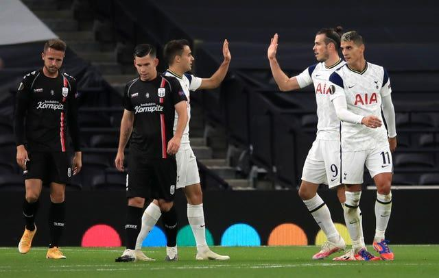 Gareth Bale, second right, high-fives Sergio Reguilon after setting up a goal against LASK