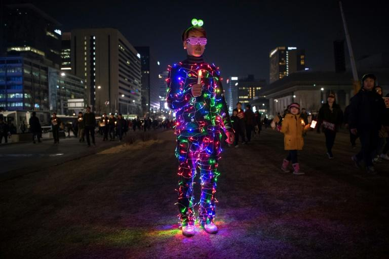 An anti-government protester wearing an illuminated costume takes part in a rally in Seoul on March 4, 2017