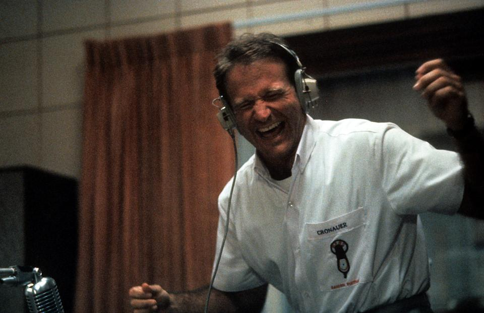 Robin Williams enjoying music through headset in a scene from the film 'Good Morning, Vietnam', 1987. (Photo by Buena Vista/Getty Images)